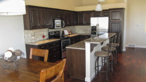 Kitchen cabinets with granite tops and travertine backsplash - the Jefferson floor plan - 1835 sq ft