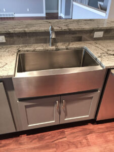 Painted custom cabinet with farmhouse sink