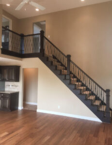 Open maple staircase with wrought iron spindles