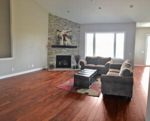 Living room with stone fireplace - the Adams floor plan - 2120sq ft - 2014 Parade of Homes