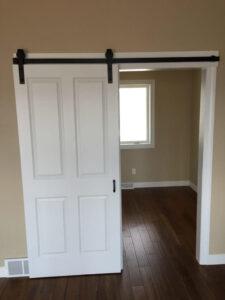 Open barn door to office - the Lincoln floor plan - 1891 sq ft