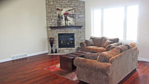 Living room with stone fireplace - the Jefferson floor plan - 1835 sq ft