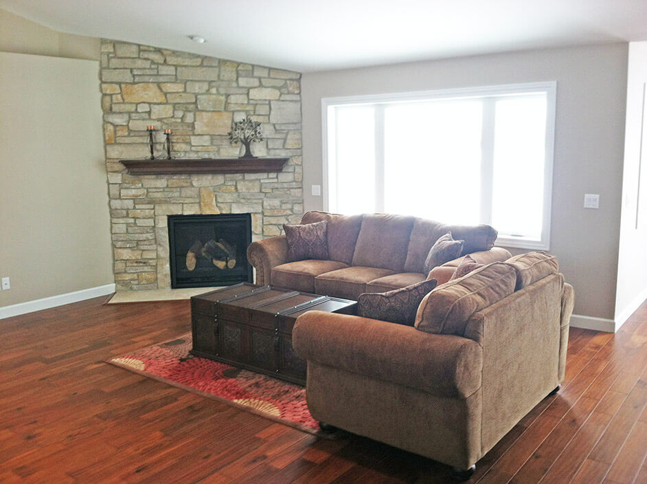 Living room with stone fireplace - the Monroe floor plan - 1707 sq ft