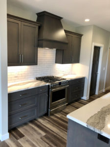 Kitchen cabinets surrounding range - 2019 Spring Tour of Homes