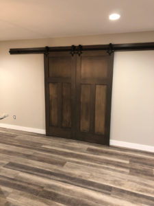Rec room barn doors closed - 2019 Spring Tour of Homes