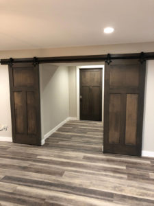 Rec room barn doors open - 2019 Spring Tour of Homes