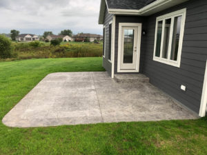 Colored stamped concrete patio - 2019 Parade of Homes