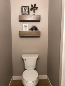 Guest bathroom with custom shelves - 2019 Parade of Homes