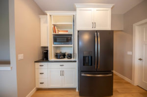 Kitchen fridge wall with appliance cabinet - 2019 Parade of Homes