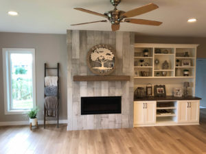 Living room fireplace and cabinets - 2019 Parade of Homes