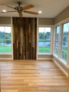 Three seasons room with tv wall - 2019 Parade of Homes